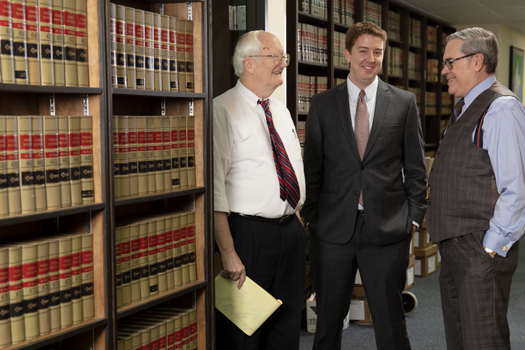 L to R:  Bob Thornton and Clark Will, Attorneys and center Brendan O'Kelly, Marketing